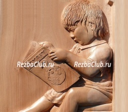 Как вырезать из дерева панно с ребенком