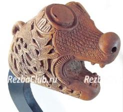 Голова дракона покрытая орнаментом
